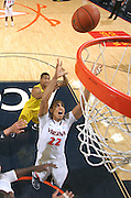 CHARLOTTESVILLE, VA- NOVEMBER 29: Malcolm Brogdon #22 of the Virginia Cavaliers grabs the rebound during the game on November 29, 2011 at the John Paul Jones Arena in Charlottesville, Virginia. Virginia defeated Michigan 70-58. (Photo by Andrew Shurtleff/Getty Images) *** Local Caption *** Malcolm Brogdon