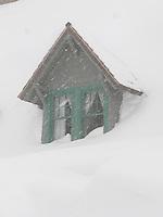 a gabled window in the snowed-in Paradise Inn at Mount Rainier National Park, Washington, USA gables of the snowed-in Paradise Inn during a snowstorm at Mount Rainier National Park, Washington, USA