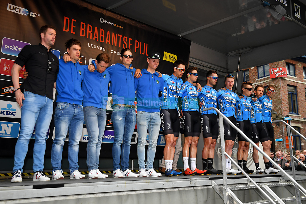 April 11, 2018 - Leuven, BELGIUM - Verandas Willems - Crelan riders pictured during a tribute to the 23 year old cyclist Michael Goolaerts who died after a crash in the Paris-Roubaix race on Sunday 8 April, at the start of the 58th edition of the 'Brabantse Pijl' one day cycling race, 201,9 km from Heverlee, Leuven to Overijse, Wednesday 11 April 2018. BELGA PHOTO DAVID STOCKMAN (Credit Image: © David Stockman/Belga via ZUMA Press)
