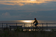 Spring Lake, NJ USA -- September 7, 2017 --A bike rider on the Spring Lake Boardwalk in the early morning hours.