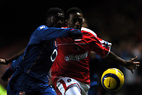 Photo: Javier Garcia/Back Page Images<br />Charlton Athletic v Arsenal, FA Barclays Premiership, The Valley 01/01/2005<br />Kolo Toure holds off Jason Euell