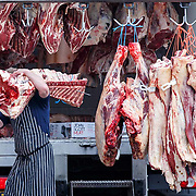 A man carries butcher meat from a lorry in Blairgowrie, Perthshire.<br /> <br /> Picture Robert Perry  28th August 2019<br /> <br /> Must credit photo to Robert Perry<br /> FEE PAYABLE FOR REPRO USE<br /> FEE PAYABLE FOR ALL INTERNET USE<br /> www.robertperry.co.uk<br /> NB -This image is not to be distributed without the prior consent of the copyright holder.<br /> in using this image you agree to abide by terms and conditions as stated in this caption.<br /> All monies payable to Robert Perry<br /> <br /> (PLEASE DO NOT REMOVE THIS CAPTION)<br /> This image is intended for Editorial use (e.g. news). Any commercial or promotional use requires additional clearance. <br /> Copyright 2018 All rights protected.<br /> first use only<br /> contact details<br /> Robert Perry     <br /> <br /> no internet usage without prior consent.         <br /> Robert Perry reserves the right to pursue unauthorised use of this image . If you violate my intellectual property you may be liable for  damages, loss of income, and profits you derive from the use of this image.