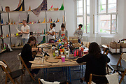 Young people taking part in a workshop in a gallery KW gallery, Berlin, Germany.