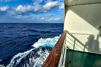 View looking forward from a port side deck protected from the wind on the MV World Odyssey. Also the shadow of the photographer. Leica T camera and 11-23 mm lens (ISO 100, 11 mm, f/14, 1/100 sec).