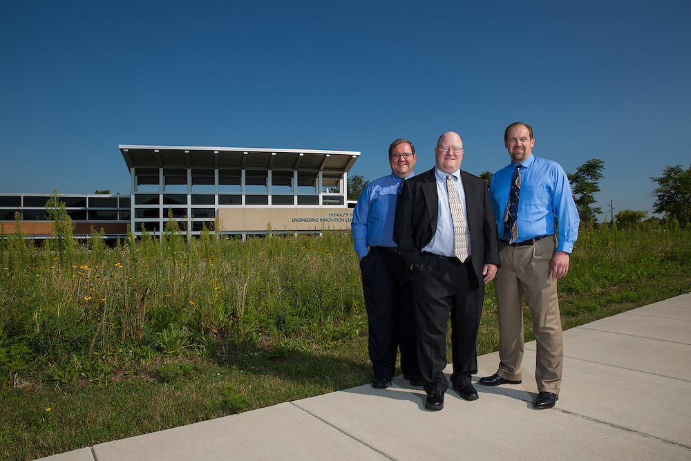 Engineering Professors Jeff Will, left, Carmine Polito, center, and Doug Tougaw in front of the Donald V. Fites Engineering Innovation Center.