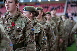 Military personnel attend the game between Middlesbrough and Wigan before the game