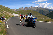 France - Tuesday, Jul 22 2008: An unidentified Lotto rider gets a tow from a gendarme motorcycle rider towards the summit of the Col de la Bonette Restefond during Stage 16 of the Tour de France. (Photo by Peter Horrell / http://www.peterhorrell.com)