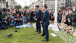 © Licensed to London News Pictures. 17/06/2016. London, UK. Former Labour party leader, Ed Milliband, Labour MP, Harriet Harman, and Labour MP, Wes Streeting, attend an evening vigil in Parliament Square for Jo Cox, Labour MP for Batley and Spen, who was murdered the previous day whilst en route to her constituency surgery. Photo credit : Stephen Chung/LNP