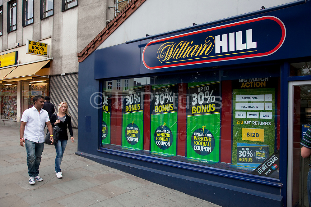 William Hill betting shop in Waterloo, London. This is one of the most well known bookmakers groups in the UK. William Hill plc is one of the largest bookmakers in the United Kingdom. Its headquarters is in north London. The company operates worldwide, employing approximately 16,600 people with main offices in the UK, Republic of Ireland and Gibraltar, offering betting by phone and Internet together with their 2300 UK-wide Licensed Betting Offices. They are the largest UK operator, representing around 25 per cent of the market throughout the UK and Ireland.