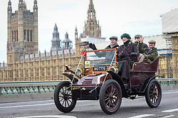 © Licensed to London News Pictures. 04/11/2018. LONDON, UK.  Participants cross Westminster Bridge en route to the coast in the 122nd Bonhams London to Brighton Veteran Car Run.  The 60 mile journey is undertaken by over 600 pre-1905 manufactured vehicles, some of which suffer frequent breakdowns.  The Run commemorates the Emancipation Run of 14 November 1896, which celebrated the Locomotives on the Highway Act, when the speed limit for 'light locomotives' was raised from 4 mph to 14 mph, abolishing the need for vehicles to be preceded by a man on foot.  Photo credit: Stephen Chung/LNP