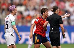 Spain's Marta Corredera (centre) speaks with referee Katalin Kulcsar (right) as USA's Megan Rapinoe looks on