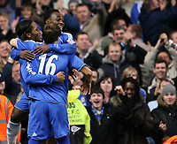 Essien and Robben of Chelsea celebrate with Drogba after his second goal of the match