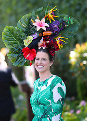 A racegoer wearing a floral hat during day three of Royal Ascot at Ascot Racecourse.