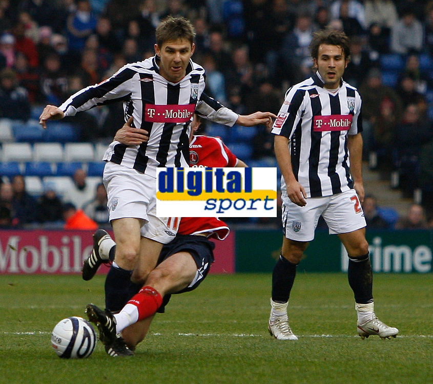 Photo: Steve Bond/Sportsbeat Images.<br />West Bromwich Albion v Charlton Athletic. Coca Cola Championship. 15/12/2007. Zoltan Gera (L) is tackled by Matthew Holland
