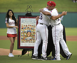 September 8, 2017 - Arlington, TX, USA - Texas Rangers third baseman Adrian Beltre hugs Rangers manager Jeff Banister (28) during the celebration of his reaching the 3,000-hit plateau earlier this season, before a game against the New York Yankees at Globe Life Park in Arlington, Texas, on Friday, Sept. 8, 2017. (Credit Image: © Max Faulkner/TNS via ZUMA Wire)