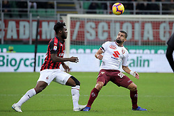 December 9, 2018 - Milan, Milan, Italy - Frank Kessie #79 of AC Milan competes for the ball with Tomas Rincon #88 of Torino FC during the serie A match between AC Milan and Torino FC at Stadio Giuseppe Meazza on December 09, 2018 in Milan, Italy. (Credit Image: © Giuseppe Cottini/NurPhoto via ZUMA Press)