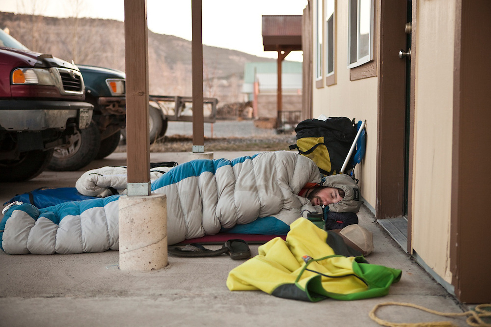 Andy Beeson sleeps outside in Ridgway before a backcountry ski trip in the San Juan Mountains of Colorado.