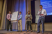 Purchase, NY – 31 October 2014. The team from White Plains High School presenting. (Left to right: Frank Marte,  Matthew Garrison, Alisa  Chaibay, Ross Van Doron.) White Plains High School went on to take first place in the 2014 competition. The Business Skills Olympics was founded by the African American Men of Westchester, is sponsored and facilitated by Morgan Stanley, and is open to high school teams in Westchester County.