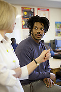 A prisoner listening to a teachers during one of his classes. HMP The Mount, Bovingdon, Hertfordshire