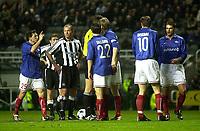 Photo. Glyn Thomas.<br /> Newcastle United v Valerenga IF.<br /> UEFA Cup Third Round Second Leg.<br /> St James' Park, Newcastle. 03/03/2004.<br /> Valerenga's Ardian Gashi (L) protests to the referee at the awarding of the free kick which Newcastle's Alan Shearer (second from L) went on to convert.