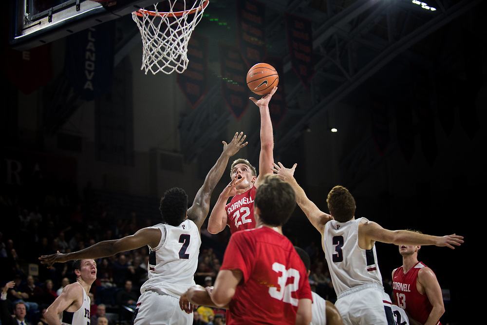 Cornell forward Josh Warren shoots a floater above Penn defenders Antonio Woods and Jake Silpe during a game at the Palestra in Philadelphia, Pennsylvania on Jan. 12, 2018.