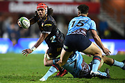Zane Kapel of the Chiefs offloads a pass as he is tackled by Jack Dempsey of the Waratahs during the Round 5 Trans-Tasman Super Rugby match between NSW Waratahs and Waikato Chiefs at Brookvale Oval in Sydney, Saturday, June 12, 2021. (AAP Image/Dan Himbrechts) NO ARCHIVING, EDITORIAL USE ONLY