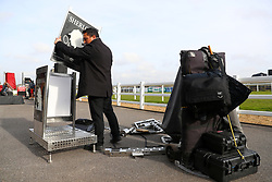 A bookmaker sets up his stand ahead of Injured Jockeys Fund Charity Raceday at Plumpton Racecourse.