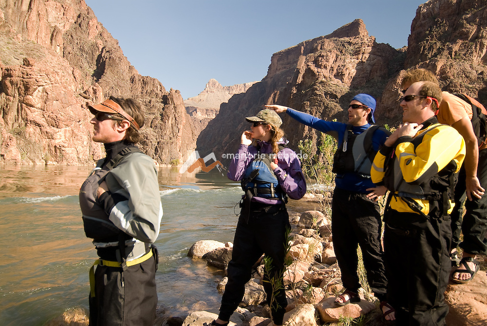 Group Scouting Granite Rapid on the Colorado River in the Grand Canyon National Park, Arizona.