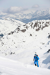 Man climbing mountain Alps snow winter