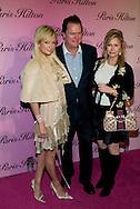 "Paris Hilton with her mother and father..Launch of ""Paris Hilton"" fragrance..5900 Wilshire Blvd..LA, CA US.12/3/04."