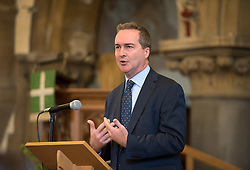 © Licensed to London News Pictures. 26/09/2016. Bristol, UK. Blue Plaque for Gordon Welchman; GCHQ Director ROBERT HANNIGAN speaks to assembled guests in St Mary's Church at the unveiling of the Blue Plaque with Gordon Welchman's daughter Susanna Griffith, and Bristol Deputy Lord Mayor Chris Davies, commemorating Gordon Welchman at St Mary's Church, Manor Road, Fishponds, Bristol. Gordon Welchman was born in Fishponds and was recruited to the Government Code and Cypher School (GC&CS) at Bletchley Park. He played an instrumental role in the development of Hut 6 and its famous code-breaking operations during WWII. Photo credit : Simon Chapman/LNP