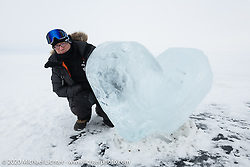 Sebastien Lorentz of Sultans of Sprint and Lucky Cat Garage in France with an ice heart in the middle of Lake Baikal while on an 30-mile excursion driving across the lake (in whiteout conditions) after the Baikal Mile Ice Speed Festival. Maksimiha, Siberia, Russia. Sunday, March 1, 2020. Photography ©2020 Michael Lichter.Baikal Mile Ice Speed Festival. Maksimiha, Siberia, Russia. Sunday, March 1, 2020. Photography ©2020 Michael Lichter.