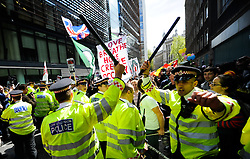 © Licensed to London News Pictures. 12/05/2012. London, UK. Occupy London protesters try to break through police lines near to the Bank of England today 12 March 2012. Photo credit : Thomas Campean/LNP.