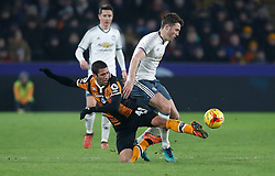 Hull City's Goebel Evandro (left) and Manchester United's Michael Carrick battle for the ball during the EFL Cup Semi Final, Second Leg match at the KCOM Stadium, Hull.