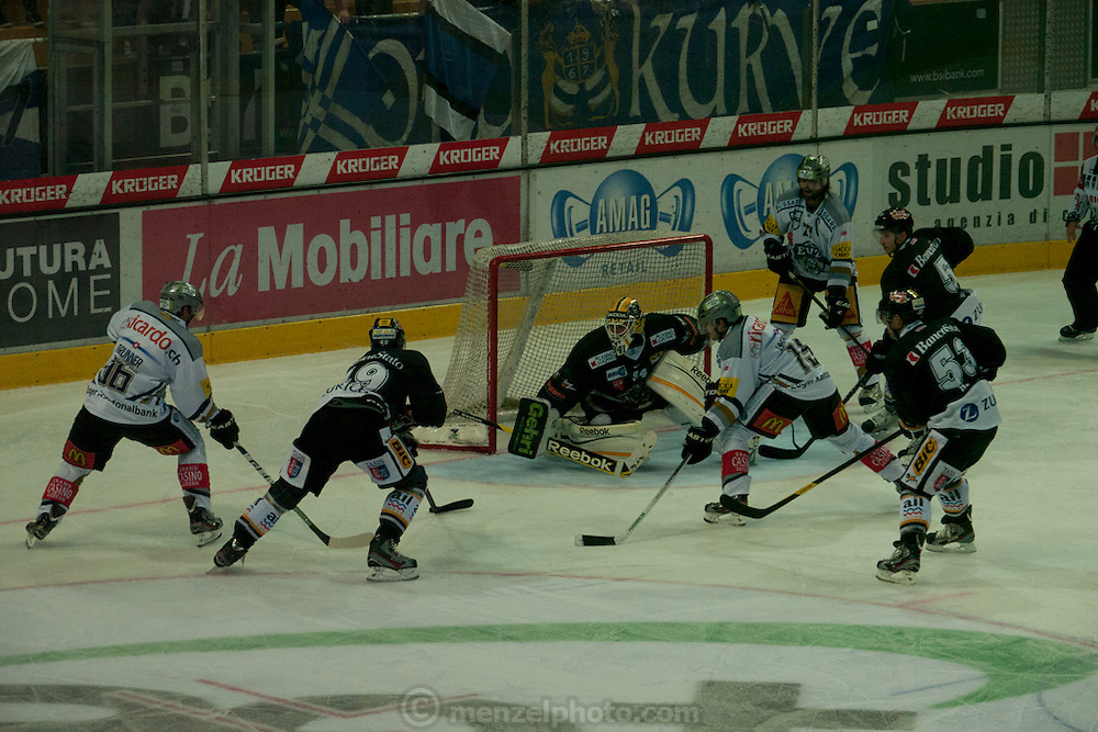 "Ice hockey game between teams from Lugano and Zurich in Lugano, Switzerland on Lake Lugano. ""Lugano is a city in the south of Switzerland, in the Italian-speaking canton of Ticino, which borders Italy. The population of the city proper was 55,151 as of December 2011, and the population of the urban agglomeration was over 145,000. Wikipedia"""