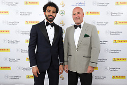 Liverpool's Mohamed Salah and sponsor during the 2018 PFA Awards at the Grosvenor House Hotel, London