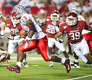 Sep 10, 2011; Little Rock, AR, USA; New Mexico Lobos running back James Wright (13) carries the ball while being persued by Arkansas Razorback linebacker Jarrett Lake (39) during the second half of a game at War Memorial Stadium.  Mandatory Credit: Beth Hall-US PRESSWIRE