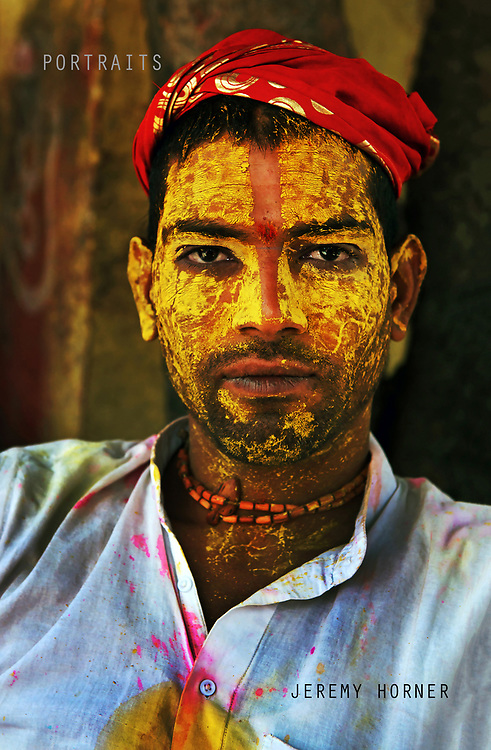 Portrait of a snake charmer. Men from Barsana raid the town whilst being assaulted with coloured water sprayed from rooftops, they are beaten by Nandgaon's women with large sticks and smeared with Holi coloured powders in a counterpart festival to the one held in Barsana on the previous day. The spectacle is a riot of colour amidst frenzied celebrations.