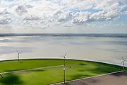 Nederland, Flevoland, Almere, 07-05-2015;  Almere-Pampus, Pampus Poort met windmolenpark grenzend aan het IJmeer. Skyline Amsterdam met IJburg aan de horizon.<br /> Windfarm near Almere, skyline Amsterdam at the horizon.<br /> luchtfoto (toeslag op standard tarieven);<br /> aerial photo (additional fee required);<br /> copyright foto/photo Siebe Swart