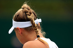 Detail of the ponytail of Emily Appleton in action during the girls singles on day eight of the Wimbledon Championships at The All England Lawn Tennis and Croquet Club, Wimbledon.