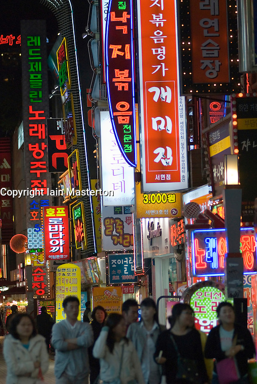 Many illuminated signs in Sameong nightlife district of Seoul South Korea at night