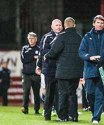 Dundee's manager John Brown and Falkirk's manager Gary Holt at the end.<br /> Dundee 1 v 1 Falkirk, Scottish Championship game at Dundee's home ground Dens Park.<br /> ©Michael Schofield.