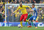 Watford Adlene Guedioura battling with Brighton's Jake Forster-Caskey during the Sky Bet Championship match between Brighton and Hove Albion and Watford at the American Express Community Stadium, Brighton and Hove, England on 25 April 2015. Photo by Phil Duncan.