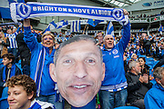 Brighton fans with a giant image of Brighton Manager Chris Hughton during the Sky Bet Championship match between Brighton and Hove Albion and Derby County at the American Express Community Stadium, Brighton and Hove, England on 2 May 2016. Photo by Bennett Dean.