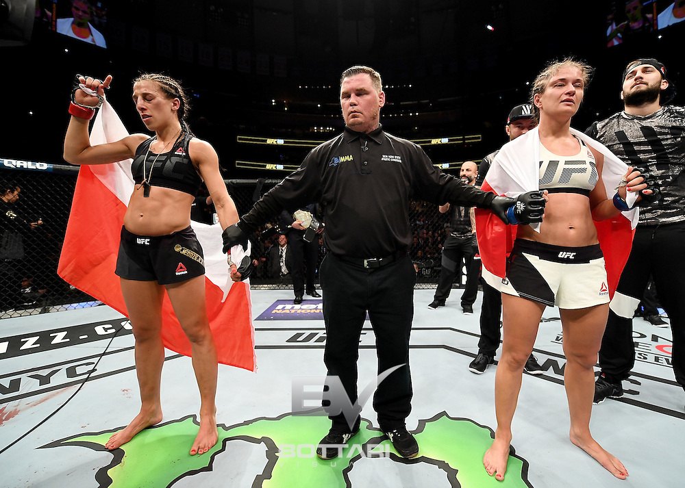 NEW YORK, NY - NOVEMBER 12: Joanna Jedrzejczyk of PolanJoanna Jedrzejczyk of Poland (left) is awarded the victory by unanimous decision against Karolina Kowalkiewicz of Poland in their women's strawweight championship bout during the UFC 205 event at Madison Square Garden on November 12, 2016 in New York City.  (Photo by Jeff Bottari/Zuffa LLC/Zuffa LLC via Getty Images)