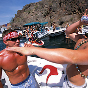 Kyle Henderson, left, and Scott Chamber party hard in Copper Canyon on Lake Havasu during Memorial Day weekend. Kyle and Scott were on a boat with a designated driver.