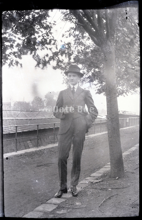 self assured young man holding cigarette 1900s