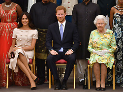 Queen Elizabeth II with the Duke and Duchess of Sussex during a group photo at the Queen's Young Leaders Awards Ceremony at Buckingham Palace, London.