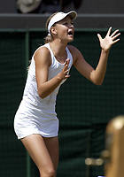 Maria Sharapova (Russia) celebrates her victory over Jelena Dokic. Wimbledon Tennis Championship, Day 6, 28/06/2003. Credit: Colorsport / Matthew Impey DIGITAL FILE ONLY