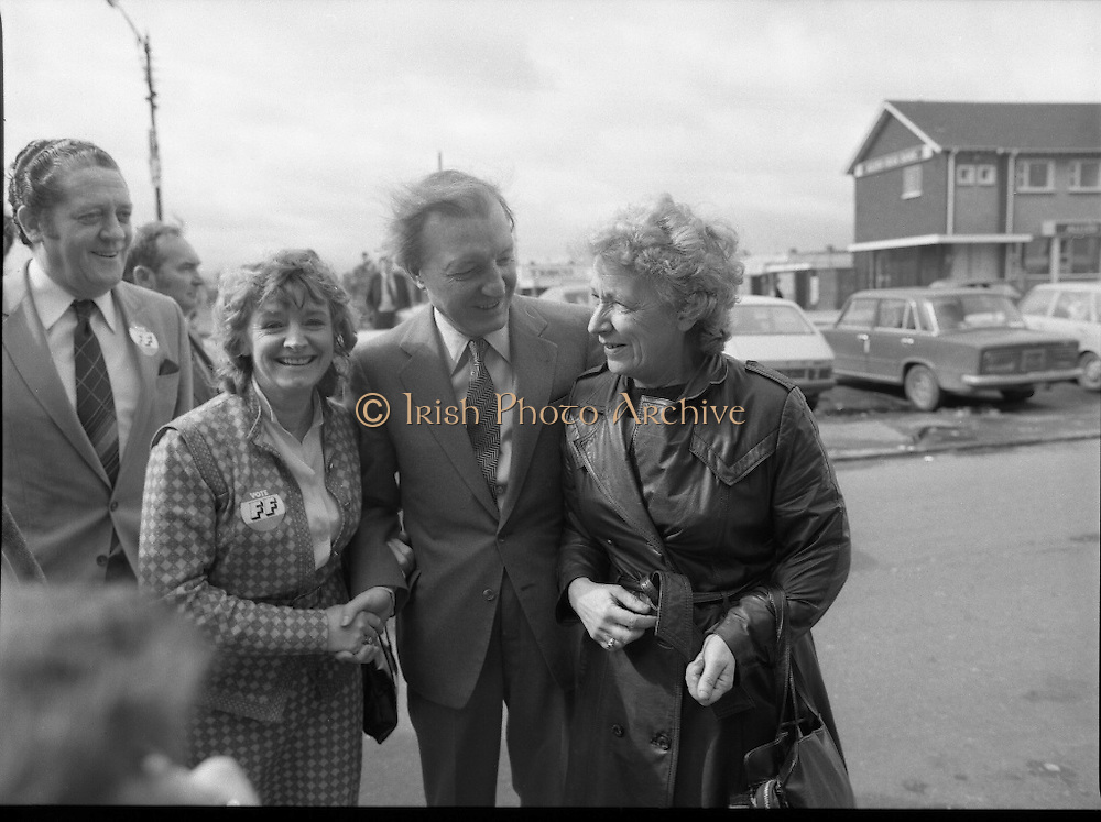 Taoiseach's Election Campaign.      (N77)..1981..23.05.1981..05.23.1981..23rd May 1981..On the 21st May the Taoiseach, Mr Charles Haughey, dissolved the Dáil and called a general election. Charles Haughey, Garret Fitzgerald and Frank Cluskey were leading their respective parties into a general election for the first time as they had only taken party leadership during the last Dáil..Fianna Fáil had hoped to call the election earlier, but the Stardust Tragedy caused the decision to be deferred..Picture shows Charles Haughey accompanied by Brian Lenihan and Eileen Lemass getting to grips with a Fianna Fáil supporter in Ballyfermot.